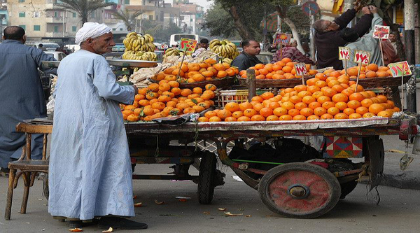 A man selling fruits.