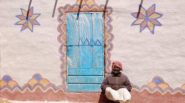 Nubian man at his house.