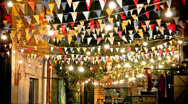 Street decorated with flags during Ramadan.