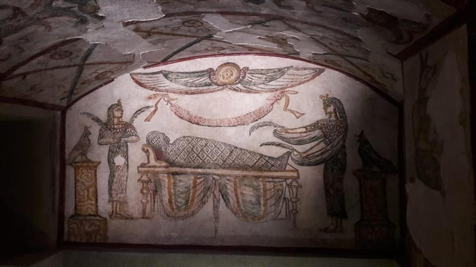 Painted scene above the central sarcophagus of the tomb