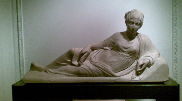 A beautiful statue of a lady.