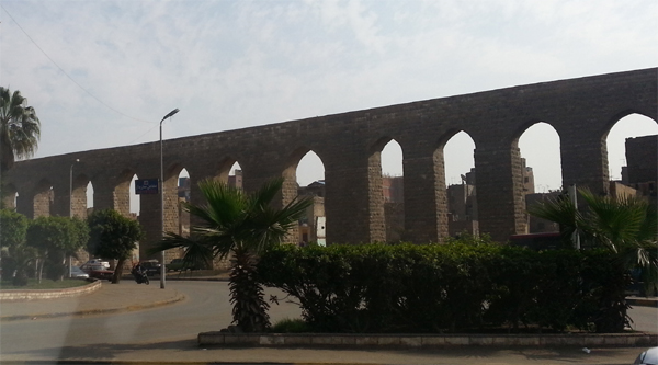 Part of the aqueduct running along a street in Cairo