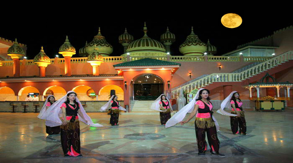 Oriental dancers at the entrance of 1001 night palace
